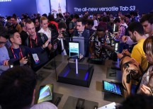 Attendees look at the new Samsung Galaxy S3 tablet in Barcelona on Feb. 26. Photographer: Chris Ratcliffe/Bloomberg
